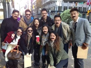 Teams playing Crime in Downtown while disguising themselves with fake mustaches.